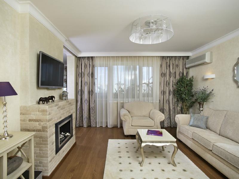 Фото дизайна зала в квартире с камином